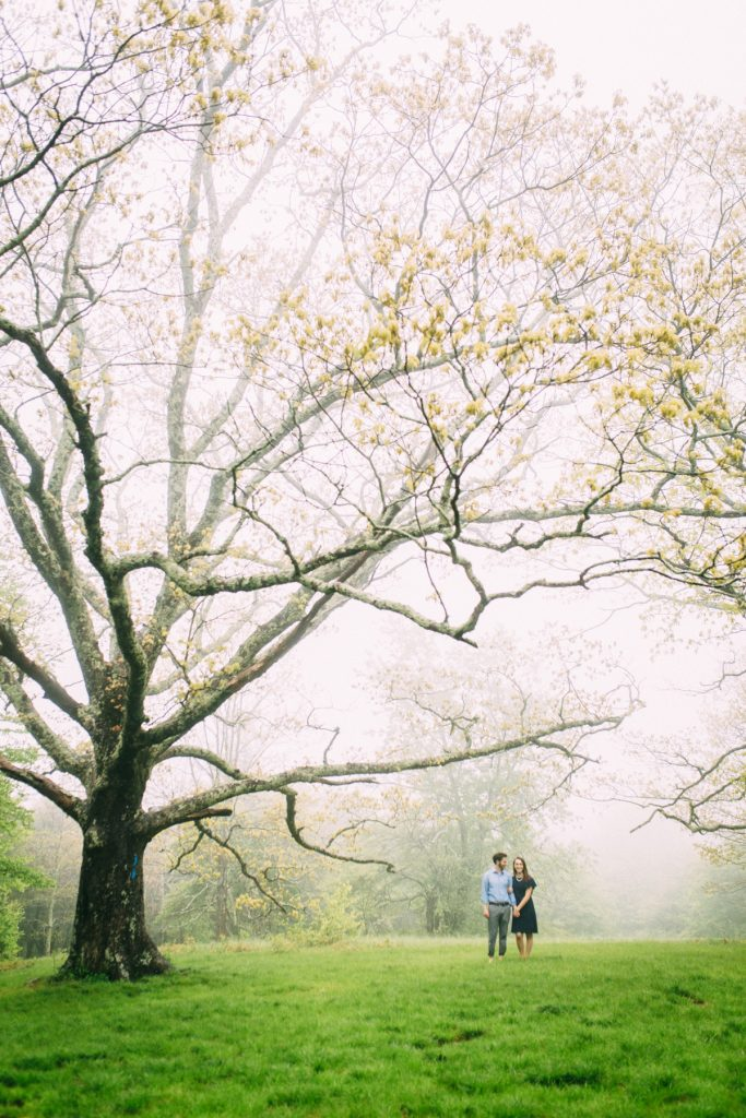 Cold Mountain Engagement Coupe holding hands in rain