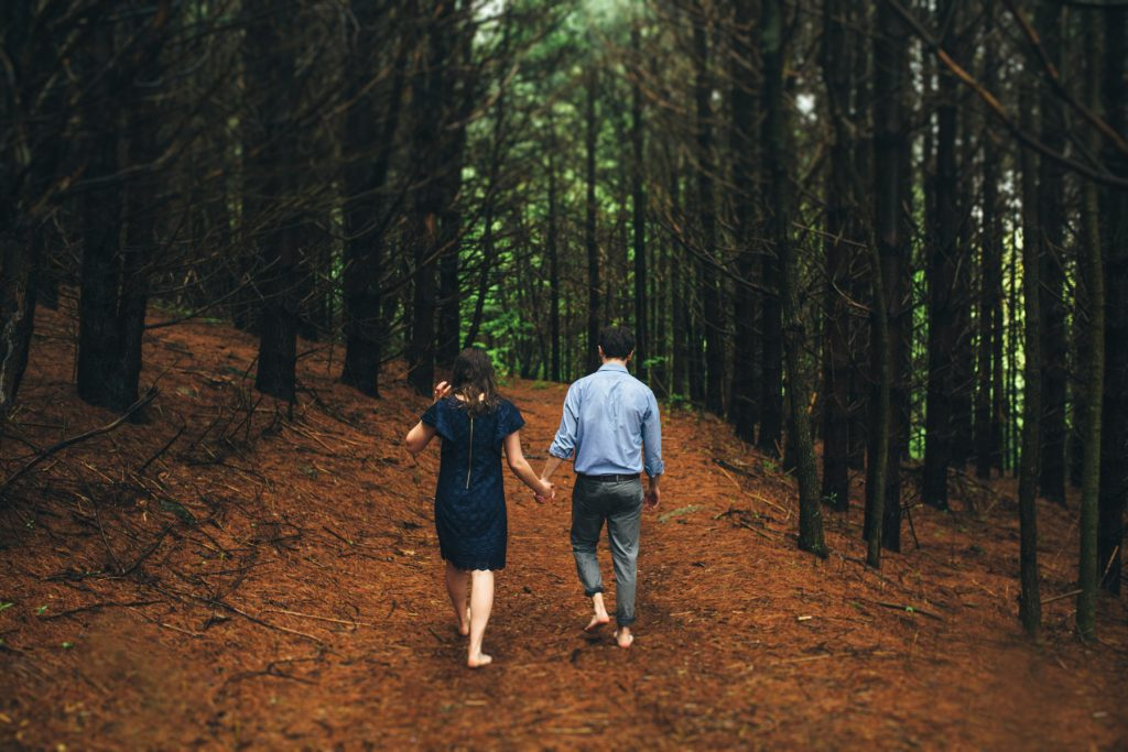 Cold Mountain Engagement Coupe holding hands walking