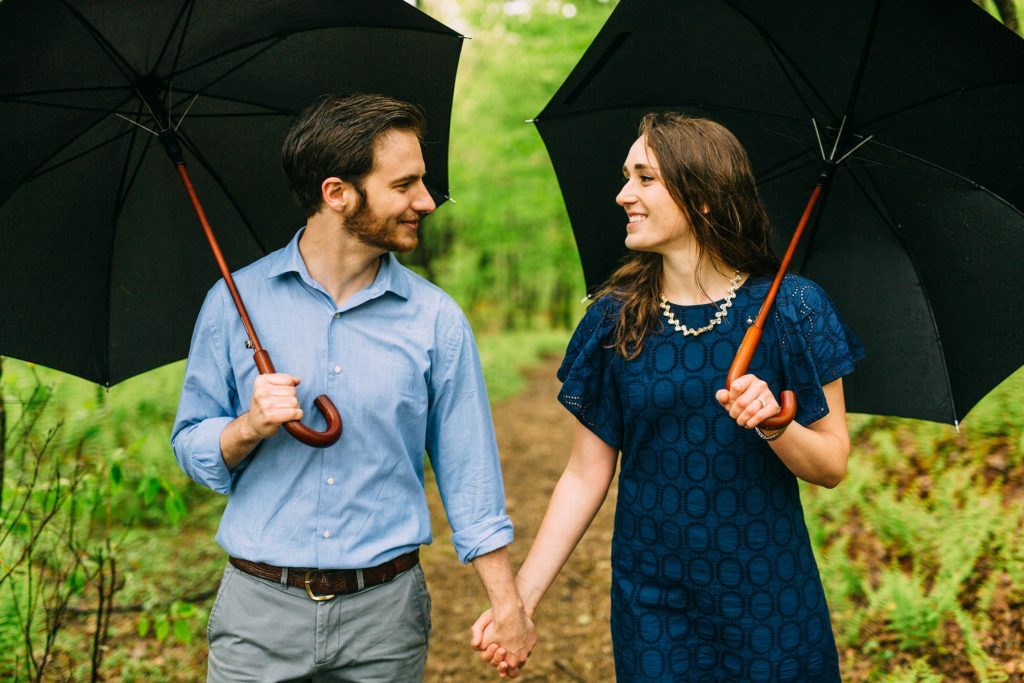 Cold Mountain Engagement Coupe holding umbrella
