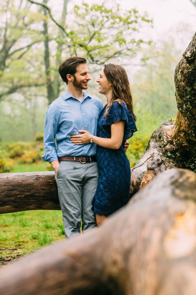 Cold Mountain Engagement Couple smiling on tree