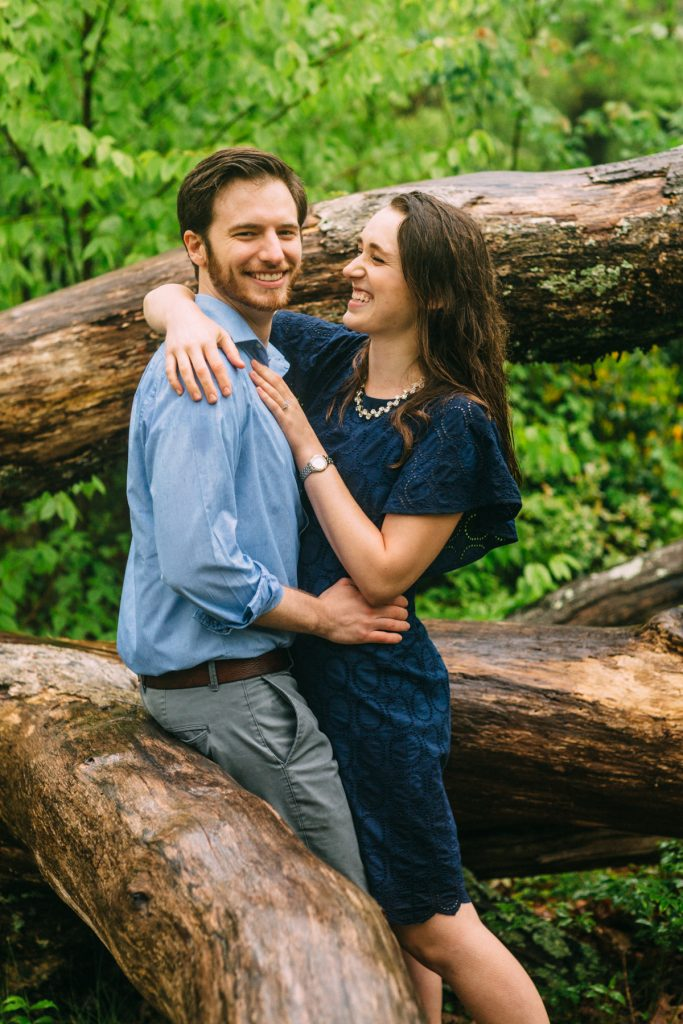 Cold Mountain Engagement Couple sitting on tree