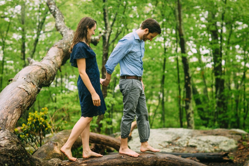 Cold Mountain Engagement Couple walking on log